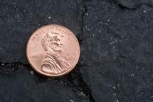 penny on asphalt