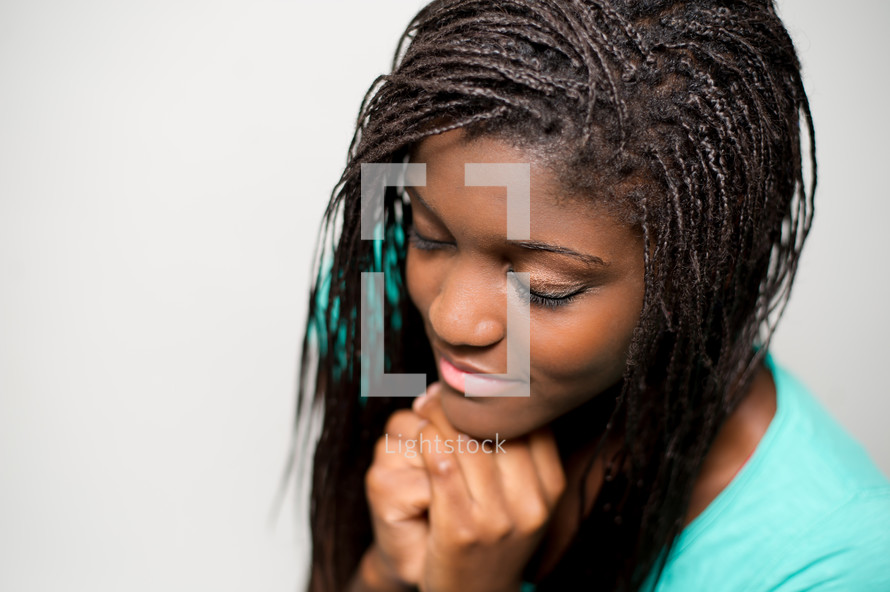 A teen girl in prayer.