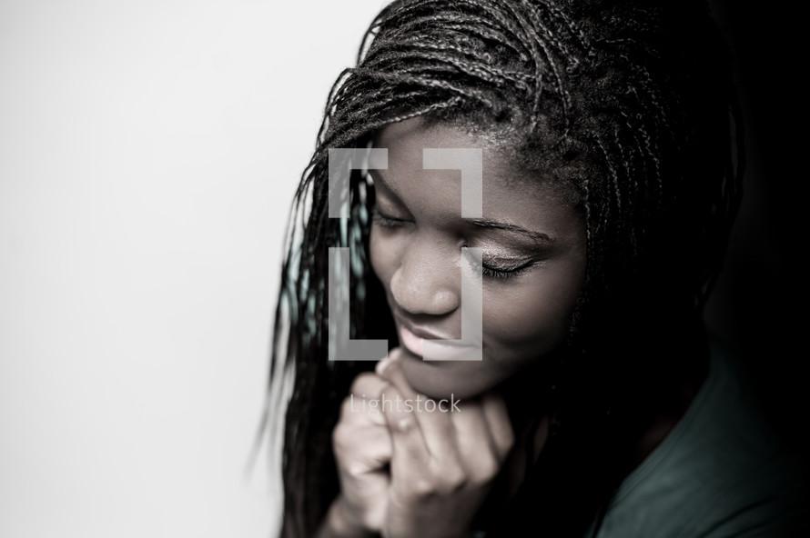 A teen girl in prayer