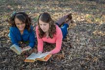 teen girls reading Bibles