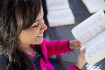 teen girl reading a Bible