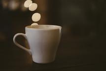 coffee cup and bokeh lights