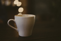 coffee cup and bokeh lights