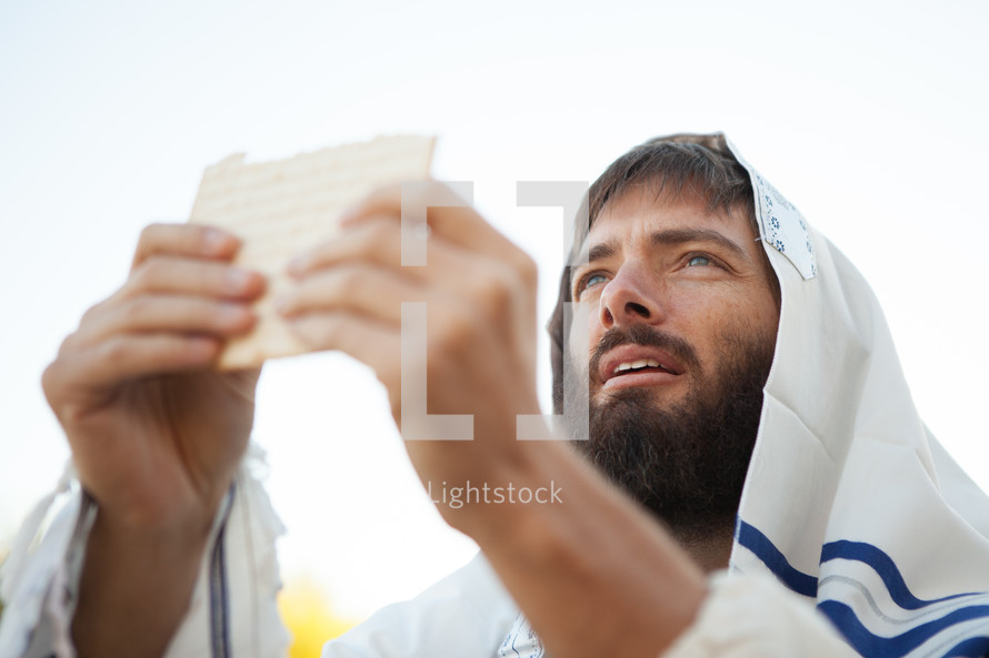 Levitical Priest Bible Character Breaking Bread from the Torah offering Communion representing the bread of life while wearing a prayer shawl. Johavah Yahweh blessing the bread that came down from heaven like the manna in the wilderness