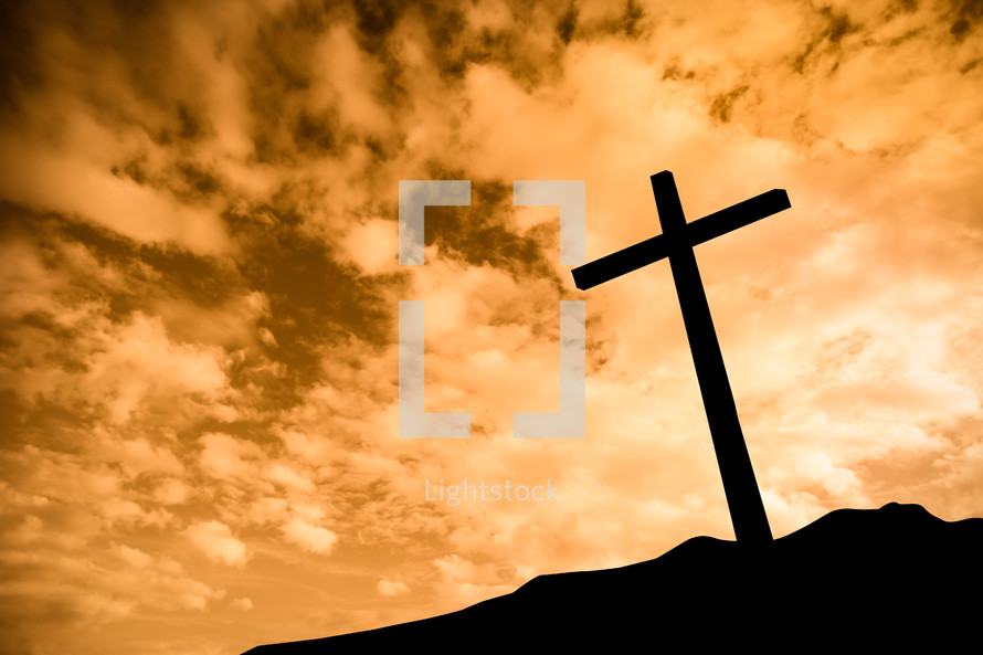 silhouette of a cross on a mount at sunrise