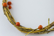 wreath of sticks and red berries