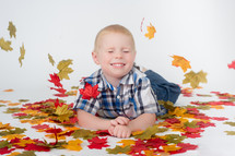 boy child and fall leaves