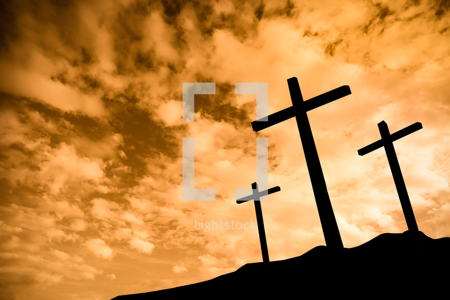 silhouettes of crosses at sunset