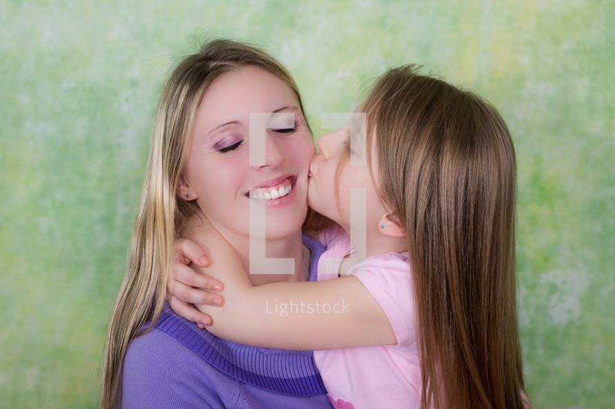 daughter kissing her mother on the cheek