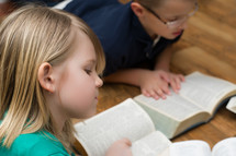 children reading Bibles