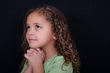 A girl child praying