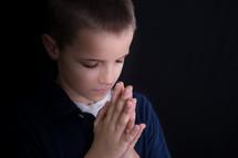 A boy child in prayer