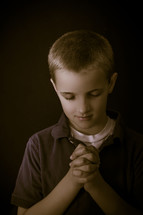 A boy child praying