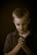 A boy child praying