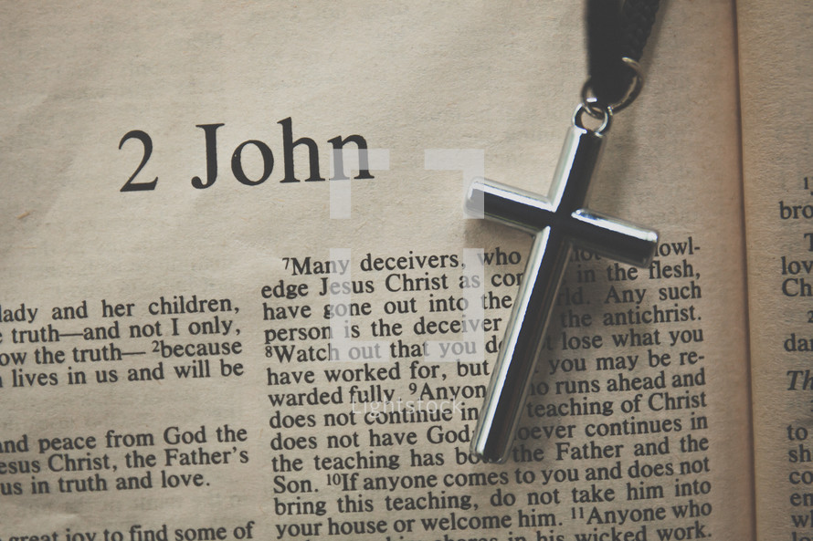 2 John and a cross necklace