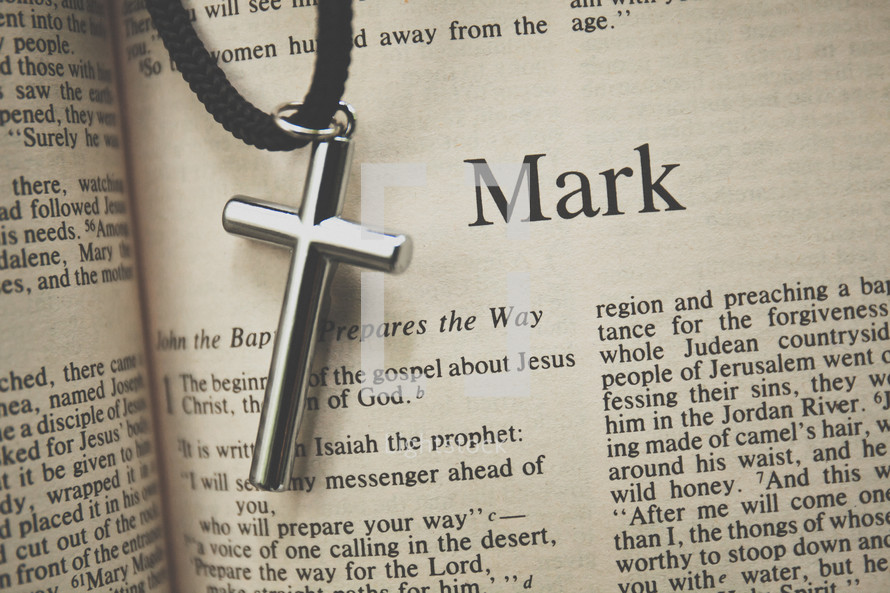 mark and a cross necklace