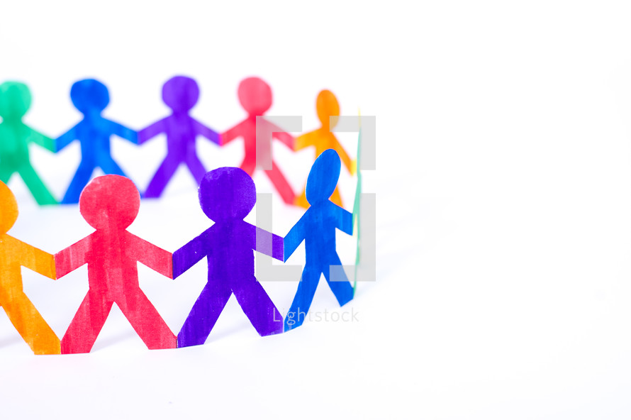 rainbow of paper dolls holding hands in a circle