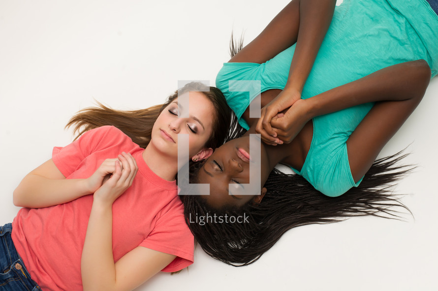 teen girl lying down in prayer