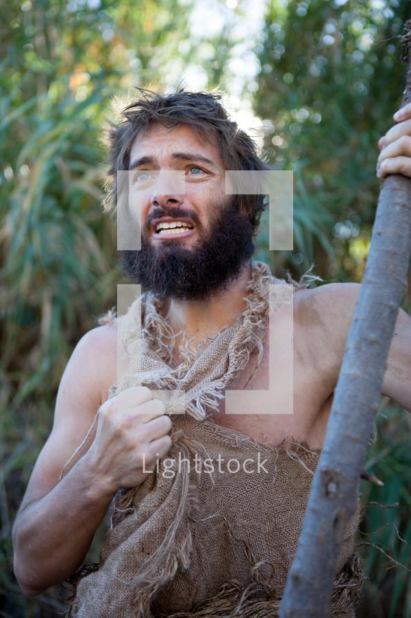 John the Baptist with walking stick.