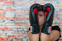 female boxer with her hands up