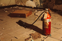 fire extinguisher in an abandoned room