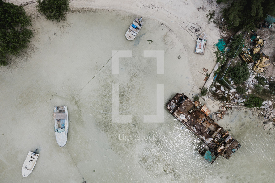 boats washed up on a beach