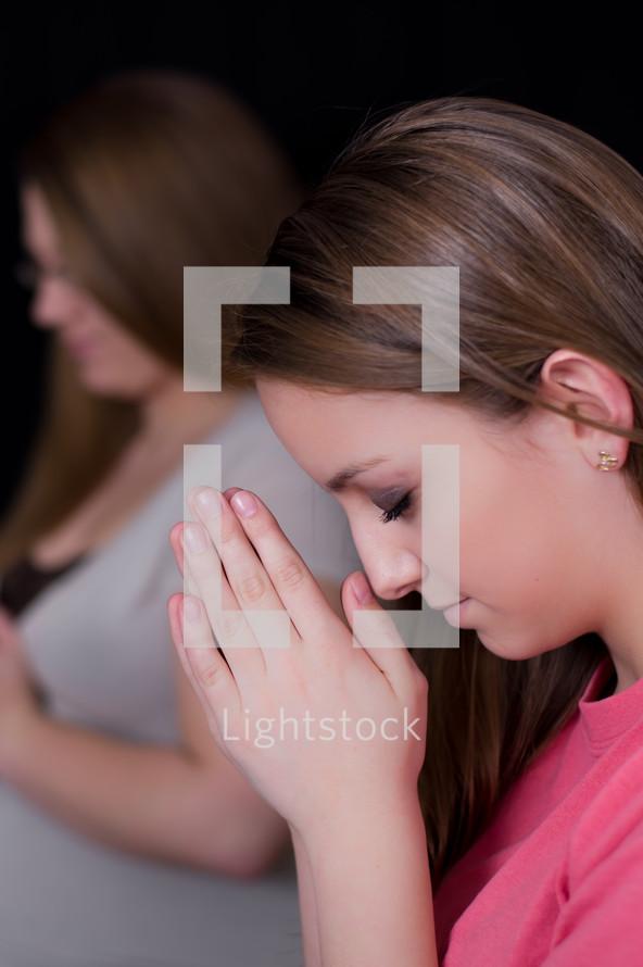 Teen girls with praying hands