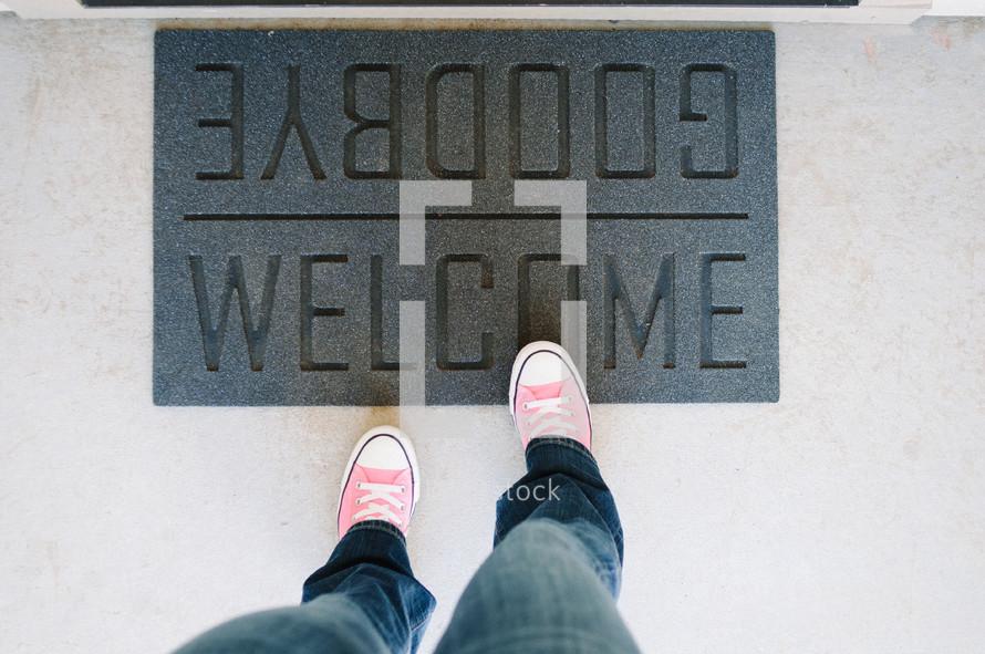 feet on a welcome mat