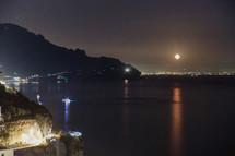 full moon over an Italian shoreline