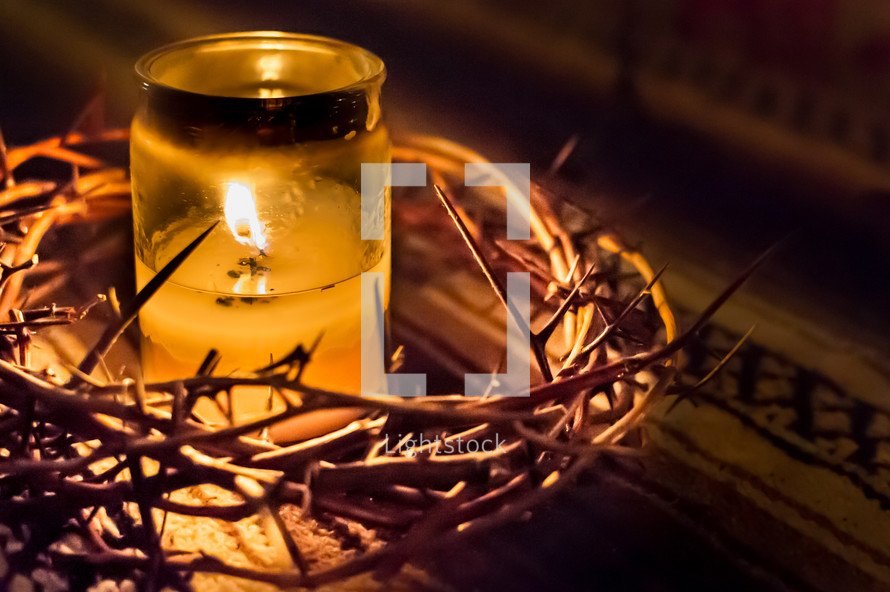 crown of thorns and a candle