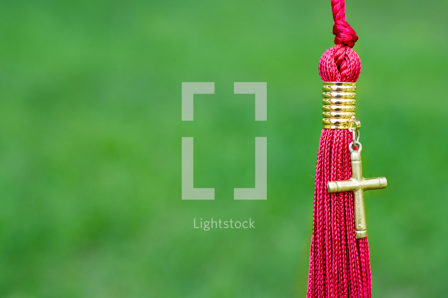 red tassel and cross