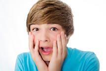 amazed teen boy