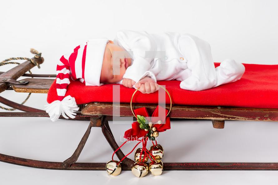 baby on a Christmas sleigh