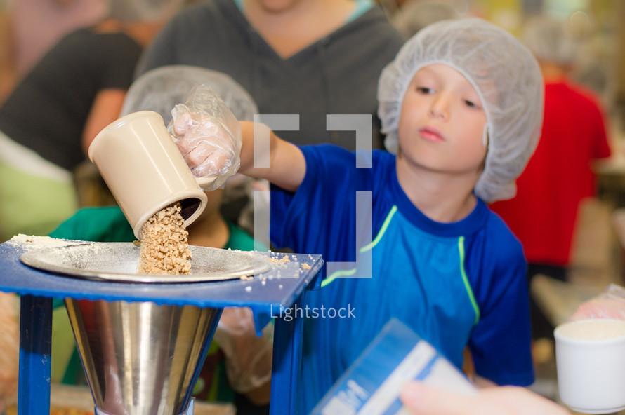 children helping in a food kitchen
