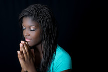 teen girl in reverent prayer