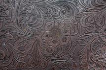 Embossed leather grain.