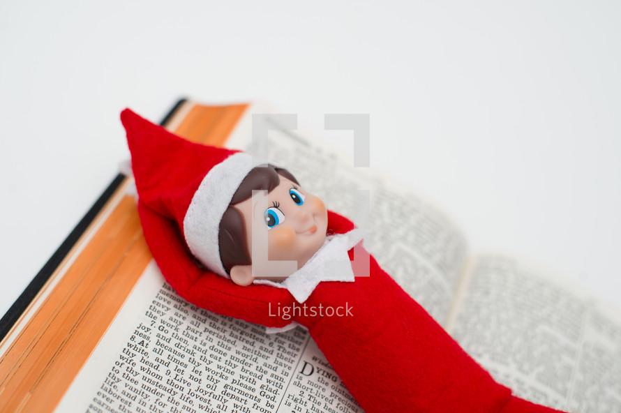 elf on a shelf on a Bible