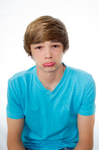 teen boy sticking his lip out