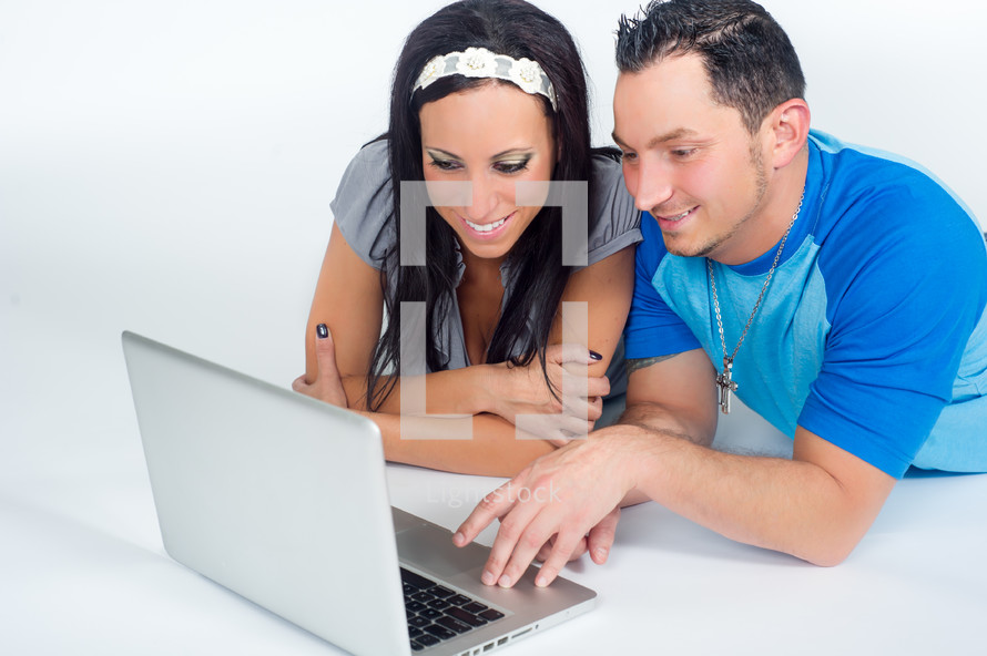 a couple at a computer