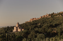 church and houses on a hillside in Italy