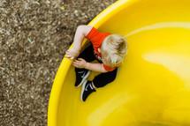 toddler boy on a slide