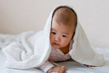 an infant under a blanket