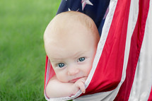 infant in an American flag