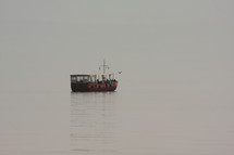 a replica fishing boat on the sea of Galilee