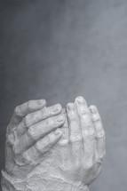 Sculpture of hands.