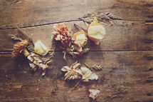 a dried bouquet scattered on wood