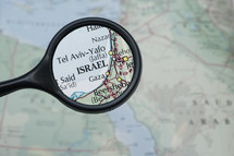 magnifying glass over a map of Israel
