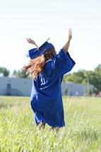 dancing in a field outside the school on graduation day