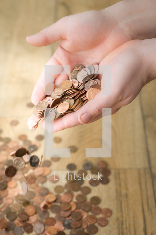 hand pouring out pennies