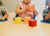 toddlers playing with blocks